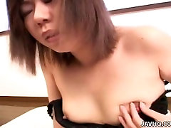 Asian bitch slips a finger in her black lacy panties
