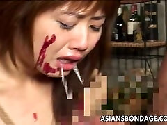 Asian slut has a cock to suck as shes tied up