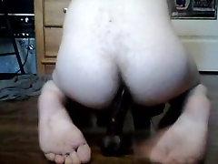 White twink sits on black dildo