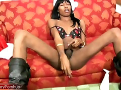 Ebony shemale masturbates black cock with sex toy in the ass
