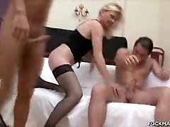 Mature In Lingerie Sandwiched In A 3some