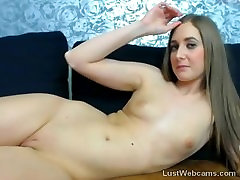 Hot babe plays with her shaved pussy on webcam