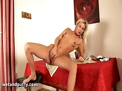 Perverted blonde Laura is pumping her lactating nipples and pussy