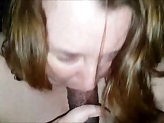 Chunky MILF giving head to a black dude