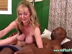 Mature sucking on black knob