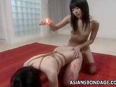 Asian slut has a bdsm session and is waxed out