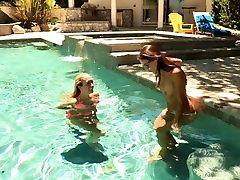Teen lesbians fool around in the pool