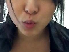Cute Asian makes a flash video at work.