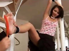 Young woman tied up and tickled