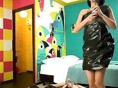 Two girls in trash bag dresses get hogtied