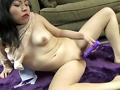 Yuka fucks her big purple toy