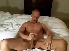Bald Muscle Hunk Jerks Off