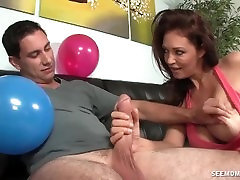 Big-titted milf sucks an erected dick