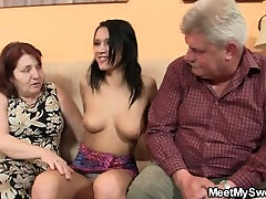 Lovely brunette sucks and rides old dick