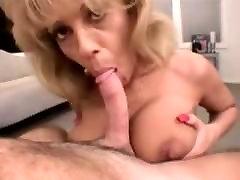 Amateur MILF sucking a cock