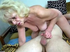 Young guy fucking granny with strap-on