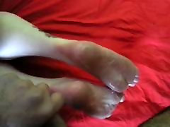Lubing her feet before foot job and cum shot