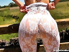 AMAZING ASS & CAMELTOE! Brunette In a White Catsuit in the middle of the Road!