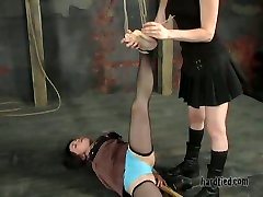 Chick wearing ripped pantyhose licks masters boots and he fucks her with long stick
