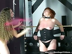Submissive redhead mom in tight corset tormented in BDSM clip
