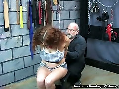 This curvy chick with curly hair seems to be enjoying her BDSM session