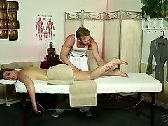 Sexy brunette client with suckable titties enjoys erotic nude massage