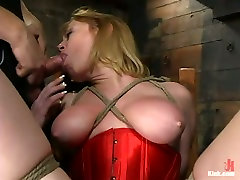 Busty whore in red corset is tied up and throated in sex vedeo relared room