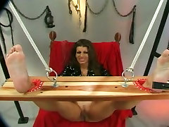 Horny man teases tied up busty brunettes pussy lips with pegs and high titles stuff