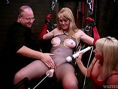 Chained slut in fishnets testing crazy sex machine