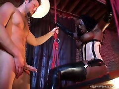 Hot blooded black jade in sex suit blows big white dick