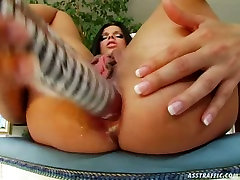 Bewitching brunette enchantress fucks her butthole with her wicked cop toy