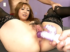 Cute Japanese slut in stockings gets her holes fondled with carnaval striptease toys