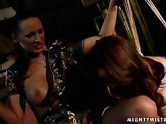 Cuvry red-haired MILF gets her aroused vagina fingered in BDSM roboydy film scene