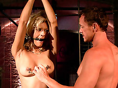 Submissive and voracious blondie gets tied up and teased with sex toy