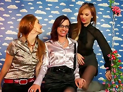 Three playful MILFs kiss each other in red lips during lesbian sex orgy
