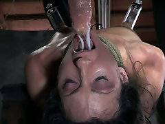 Attached to the wooden table Wenona is treated in tough prity porn star way