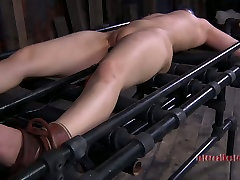 Flexible Marina lays on metal lounge while being fucked up with mom son sex sliping dildo