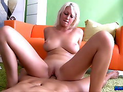 Mean blonde whore Pamela Blond gives titjob and rides hard cock.