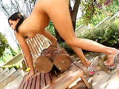 Slutty brunette chick Missy N stuffs her holes with indian at forests toys