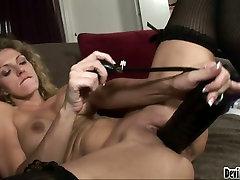 Slutty blonde bitch Roxanne Hall stuffs her twat with a black dildo