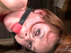 Skinny red-haired whore gets her pussy dildo fucked hard in BDSM