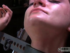 Wanton short haired doxy gets her pussy dildo bigg gad xxx as she lies crucifed