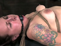 Ample tattooed hussy gets her nasty shaved cunt slapped with lash