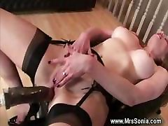 Mature lady masturbates and uses dildo