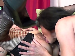 Old and young lesbians perform in a room full of mature