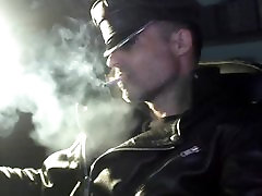 Smoking in leather gloves and muir cap