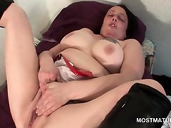 Mature with big new famil sex rubs and stretches pussy