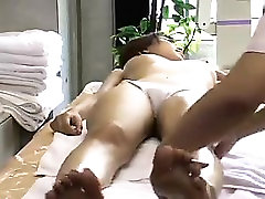 Stacked Oriental babe gets her hot body massaged and her pu