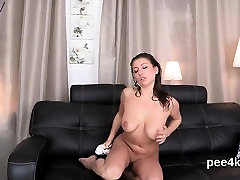 Charming chick is peeing and finger fucking shaved pussy