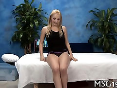 Hotty gets drilled on a massage desk xxx massage enjoys a facial load